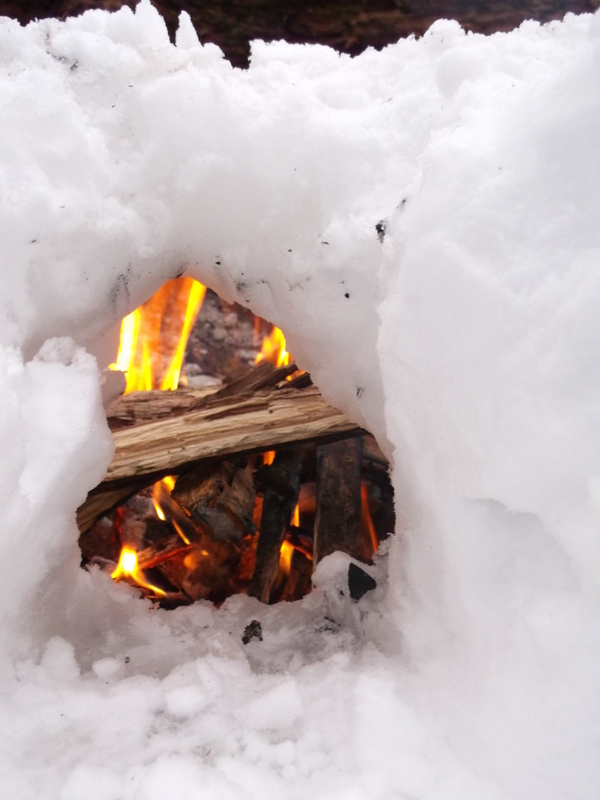 Making an Air hole for camp fire in winter - Algonquin