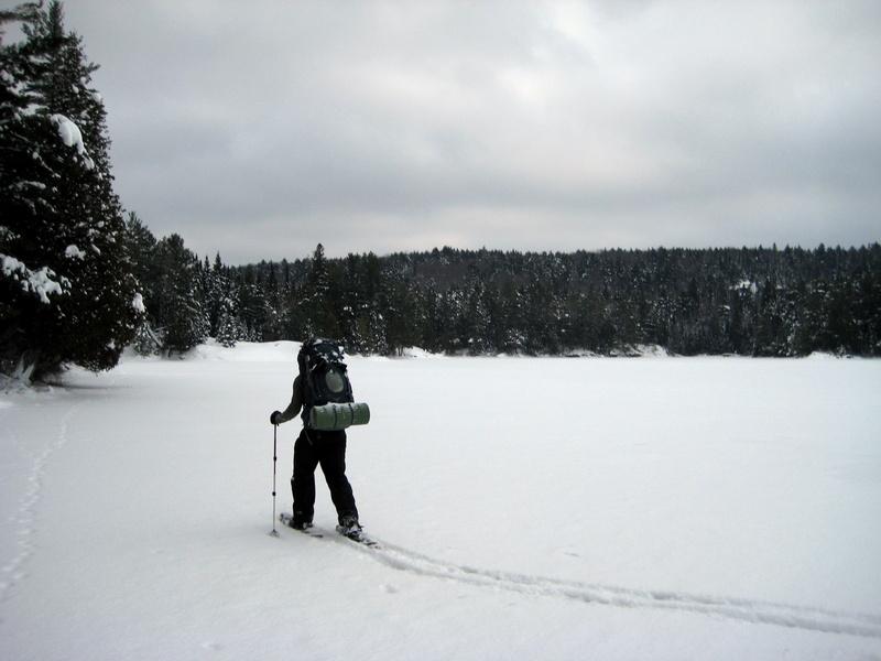 snowshoeing over frozen lake - algonquin